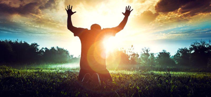 Prayer in the morning in a beautiful sunrise.